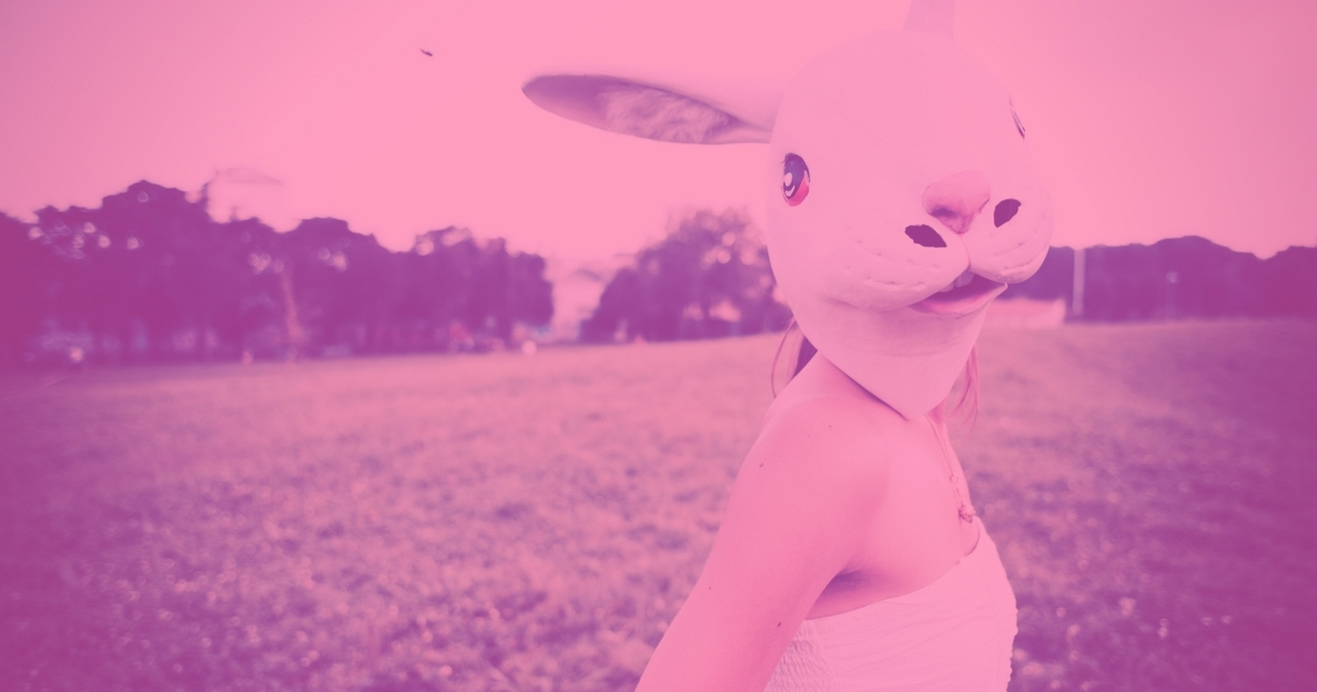 Girls in white rabbit mask with field in backgrould