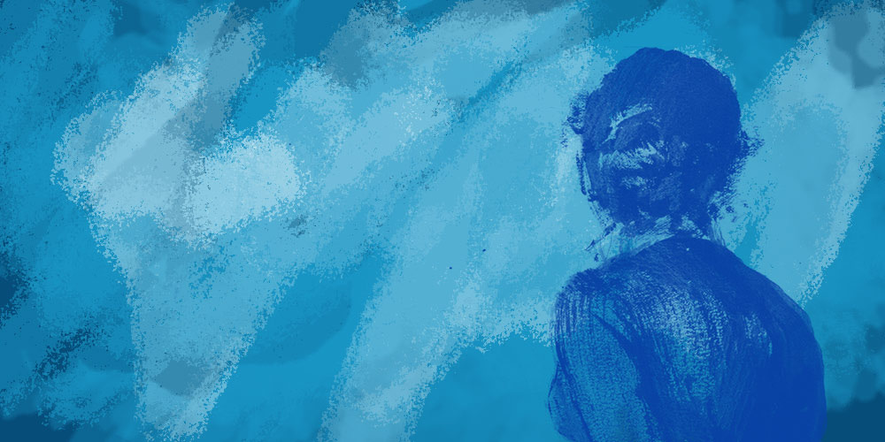 Back of woman facing blue background