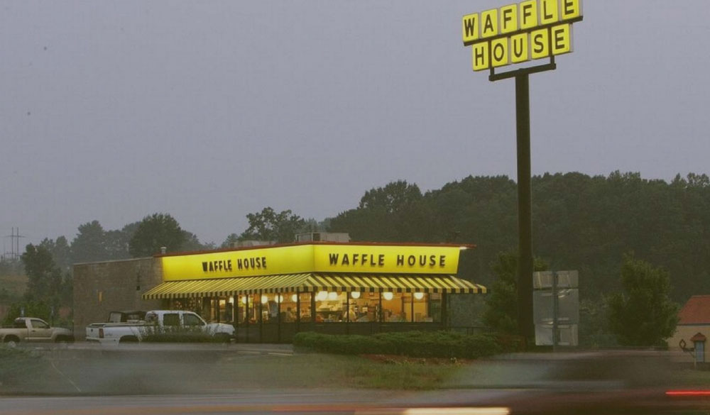Waffle House on a Rainy Evening, rural area, surrounded by trees.