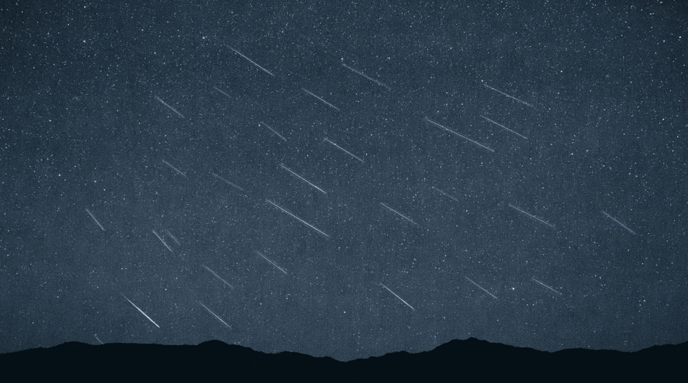Perseid Shower, blue overlay, night sky.