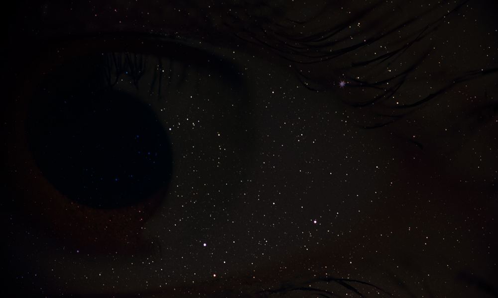 Eyes set back behind dark sky/stars