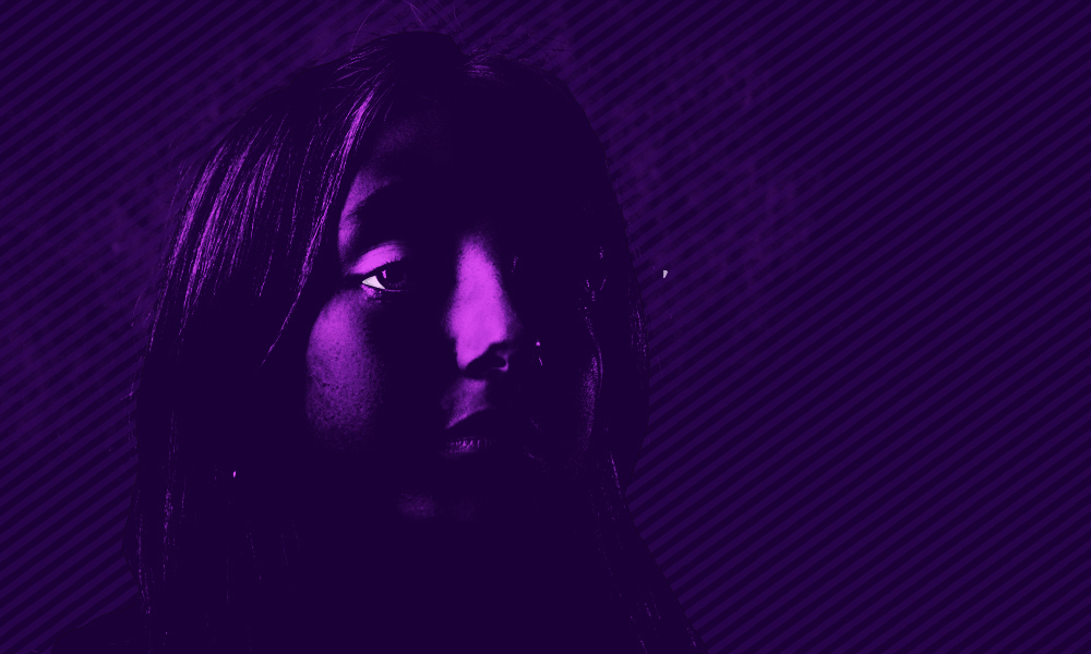A purple human face set against a darker background looks to the right.